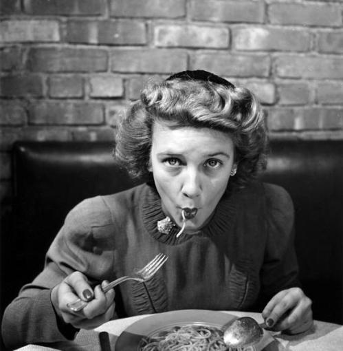 Woman eating spaghetti in restaurant #5 of sequence of 6