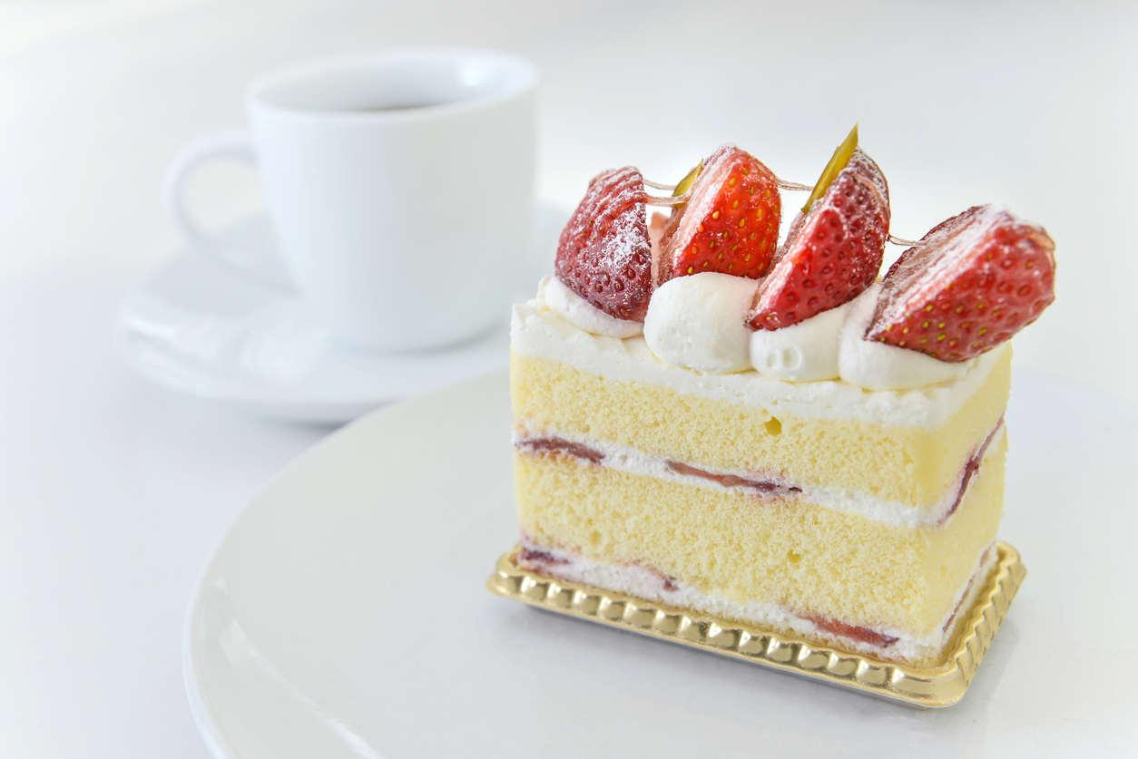 Strawberry cake on white background